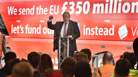 Boris Johnson speaks to employees during a visit to Reid Steel, Christchurch in front of the £350m m
