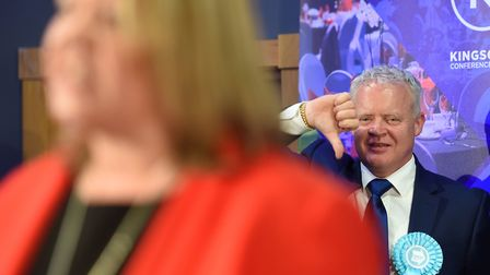 Brexit Party candidate Mike Greene gives a thumbs down as newly elected Labour MP Lisa Forbes gives