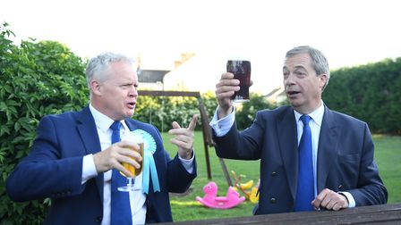 Brexit Party leader Nigel Farage (right) and party candidate Mike Greene have a drink at The Bull pu