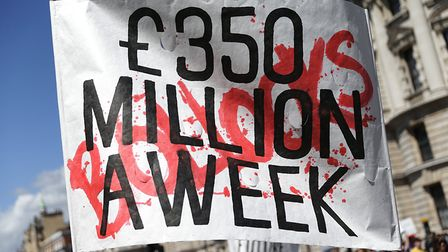 A sign is held in at an anti-Brexit protest branding the £350m a week Vote Leave claim 'bollocks'. (