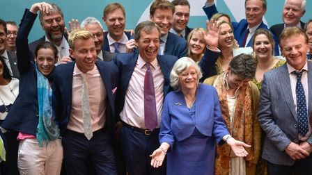Brexit Party leader Nigel Farage poses with newly elected Brexit Party MEPs. (Photo by Peter Summer
