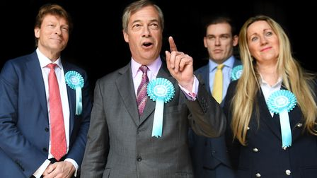 Brexit Party leader Nigel Farage with chairman Richard Tice (left) and Eastern region candidates Mic