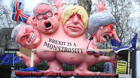 Effigies of Theresa May, Boris Johnson, Michael Gove and David Davis, are driven past the Houses of