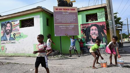 Children play in the Trench Town neighborhood of Kingston, Jamaica on May 18, 2019. Picture: ANGELA