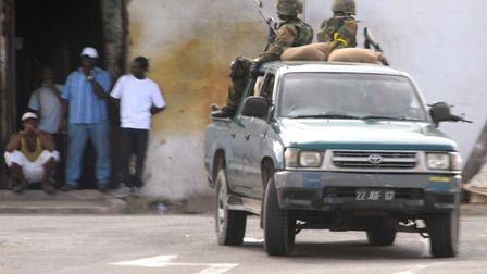 Members of the Jamaica Defence Force patrol a section of western Kingston in the Jamaican capital. P