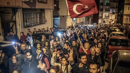 Protesters march with Turkish flag during a demonstration in Istanbul, on May 8, 2019, following a d