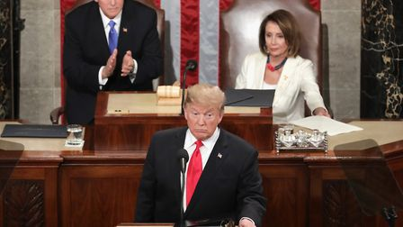 President Donald Trump, with Speaker Nancy Pelosi and Vice President Mike Pence looking on, delivers