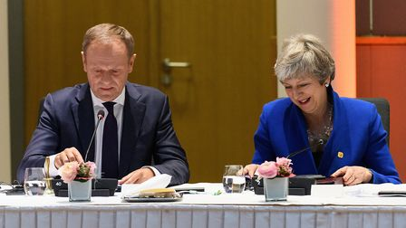 President of the European Council Donald Tusk and Theresa May attend a round table meeting in Brusse