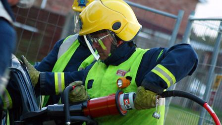 Firefighters used specialist cutting equipment to free the person trapped in the car.