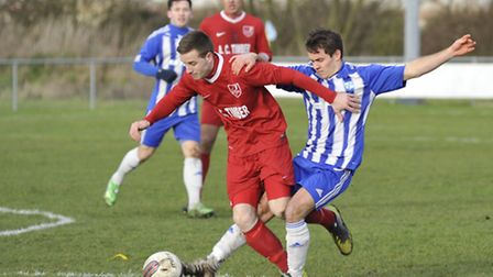 GETTING STUCK IN: The Godmanchester Rovers v Ely City match wasn't one for the faint-hearted. Pictur