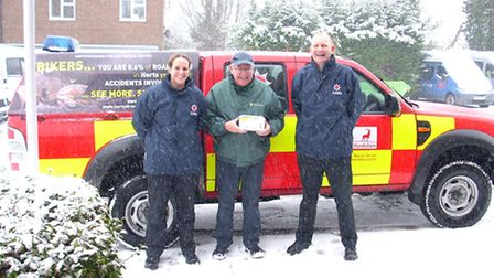 Firefighters Abigail Hampton and Paul Neilson, pictured with John Gardner from community meals