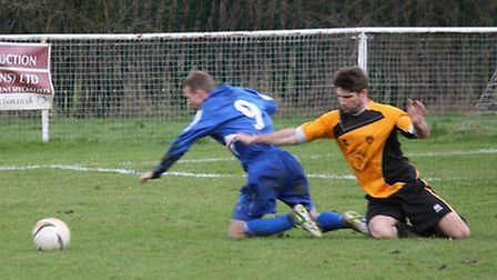 Matt Newman being felled in the box, no penalty was given. Pictures by Jim Whittamore