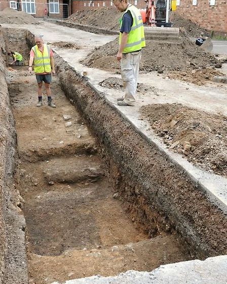 Checking the trenches in the dig for the remains of King Richard III. Photo courtesy of University o