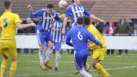 IN THEIR DEFENCE: Stephen Hurst gets above the Kirkley mob to clear the ball. Picture: Helen Drake.