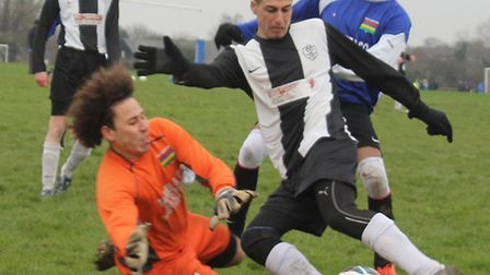 Herts Mauritian keeper Ricky Figg comes flying out of goal to block a Colney Heath Rangers shot