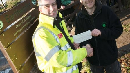 Jeremy Alden, technical director from Linden Homes presents the funds to project leader at Earthwork