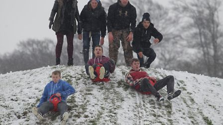 People enjoy the snow on the heath