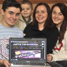 Battle The Boredom Website made in St Neots by (l-r) Kyle Salter (14), Callum Salter (4), mum Donna