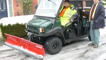 Cllr Bernard Roberts and his son Simon with the gritter