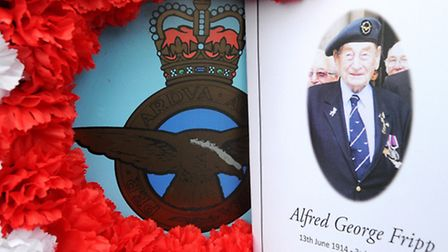 Pictured here is a floral tribute and order of service for the late Alfie Fripp. From Blenham bomber