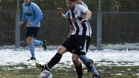 ON THE BALL: Lee Ellison controls the ball against Cambridge University Press. Picture: Louise Thomp