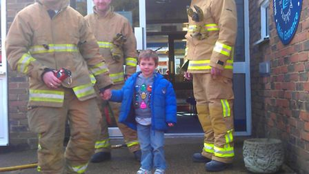 Joshua Pepperrell talks to firefighters at Lea Primary School in Harpenden