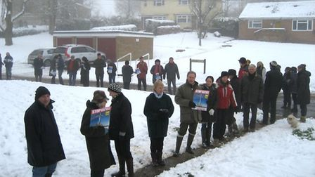 Residents stage a 'queue' outside a surgery abot Molesworth wind farm being held by RWE npower renew