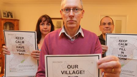 Mike Swann stands in front, with Emma Alecock and Alan Hadwen, campaign about a possible housing dev