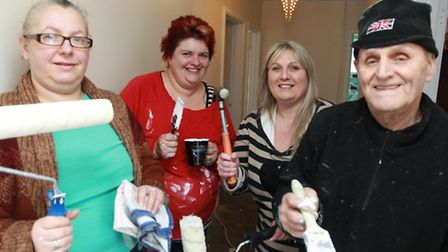 Volunteers, Selina Fowler, Ali Kingsley, Amanda Smith and Terry Hutt help to redecorate disabled man