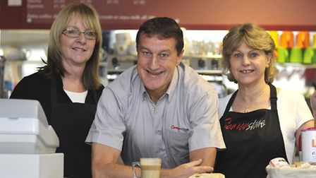 St Neots Cafe owner Paul Shinners says thank you to his customers, with staff (left ) Patsy Delaney-