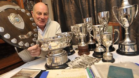 SILVERWEAR: Colin Leach with the St Ives & District Angling Society history books and trophies. Pict