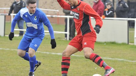 ON THE BALL: Huntingdon Town's Jamie Graham gets tricky against Spalding United. Picture: Helen Drak