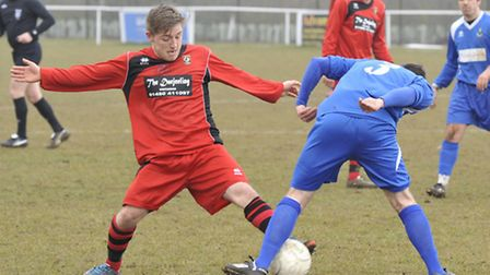 GIVING IT ALL: Ben Seymour-Shove in action for Huntingdon Town at Jubilee Park on Saturday. Picture: