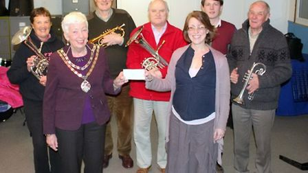 Royston's Mayor Lindsay Davidson receives a cheque from Royston Town Band's Charmain FLoweday