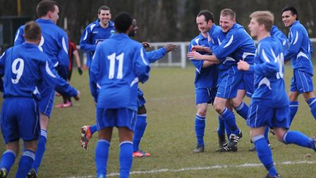 Kenny Hull is congratulated by his team mates.