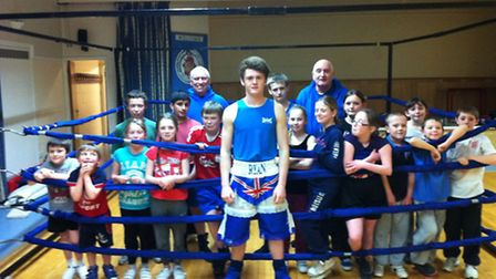 CHAMP AND HIS FANS: Ryan Adair at the Medway Centre with the Cambs Police Boxing Club's youngest mem