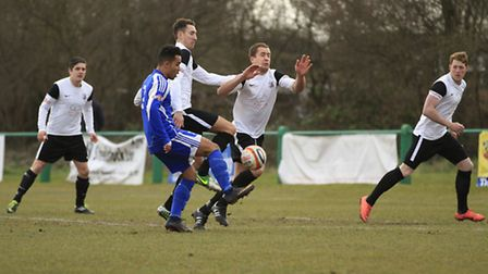 Royston outnumber a North Greenford United opponent. Picture by Kevin Richards