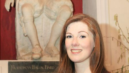 Briony Rawle stands in front of Sir Francis Bacon's statue in St Michael's Church.