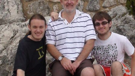 James, left, with his father Dr David Forster and his brother Edward.