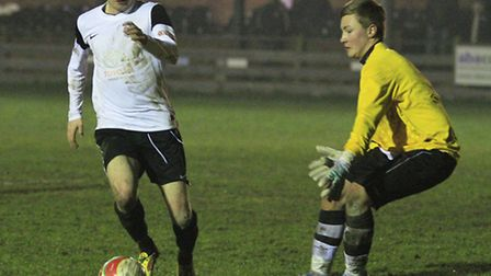Luke Robins rounds the keeper to net. Picture by Kevin Richards