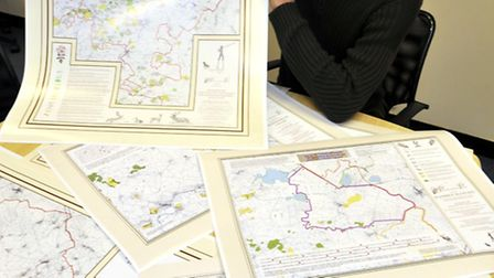 Huntingdonshire Historian Jason Peters with his maps