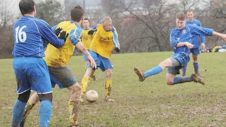 A lunging tackle from a Bradmore Rovers Res defender.