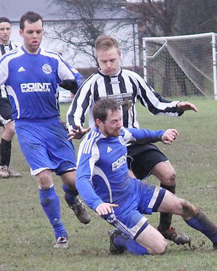 Two Blackberry Jack players force out a FC Potters Bar player.