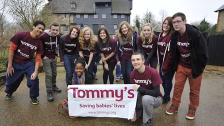 Cromwell students doing a charity walk for teacher (front right) Jon Scotland, who is raising money