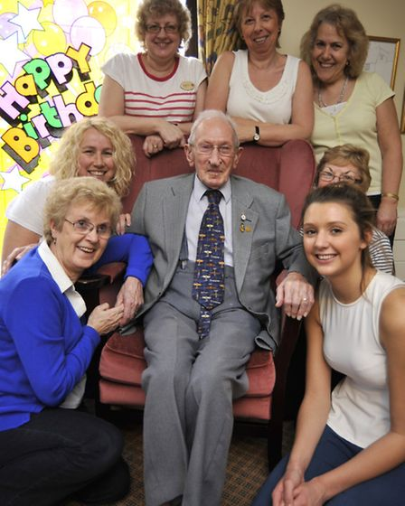 100 year old Jim Dale at Rose Cottage, Broughton, with some of his carers