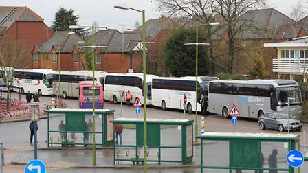 A line of replacement coaches waiting at St Albans City train station for FCC passengers affected by