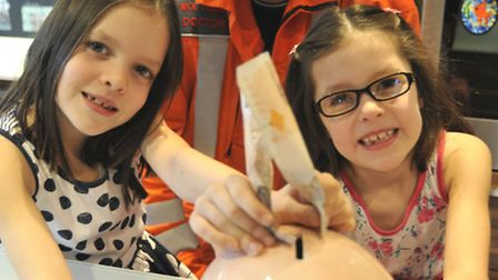 Seven Year Old Twins Fundraise for Magpas (l-r) Olivia and Lauren Bocking at their home in Stukeley