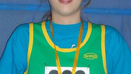 RECORD BREAKER: Harriet Bruce, 12, won a gold at the Eastern Indoor Championships - and broke five H