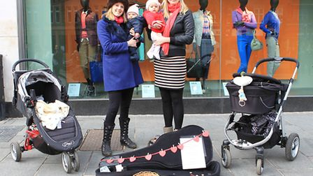 Sally Williams and Laurenne Chapman with their daughters, singing on St Peters Street