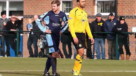 DIFFERENT SHIRTS: St Neots Town's Adrian Sear marks ex-team-mate Stefan Moore. Picture: Andy Wilson.